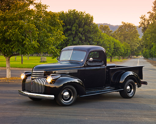 AUT 14 RK1639 01 © Kimball Stock 1946 Chevrolet Pickup Truck Black 3/4 Front View On Pavement By Grass And Trees