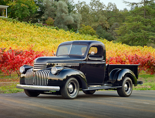 AUT 14 RK1640 01 © Kimball Stock 1946 Chevrolet Pickup Truck Black 3/4 Front View On Pavement By Vineyard