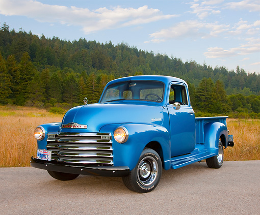 AUT 14 RK1644 01 © Kimball Stock 1948 Chevrolet Thriftmaster Pickup Truck Blue 3/4 Front View On Pavement By Meadow And Trees