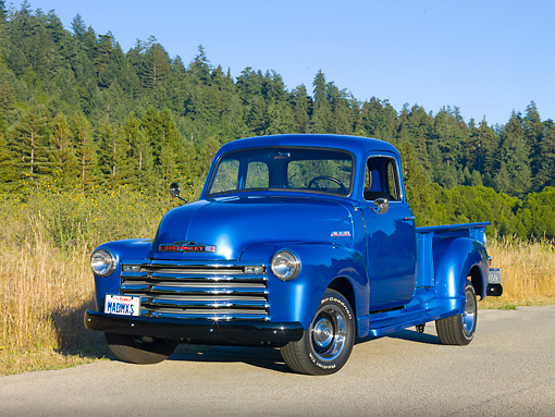 AUT 14 RK1646 01 © Kimball Stock 1948 Chevrolet Thriftmaster Pickup Truck Blue 3/4 Front View On Pavement By Meadow And Trees
