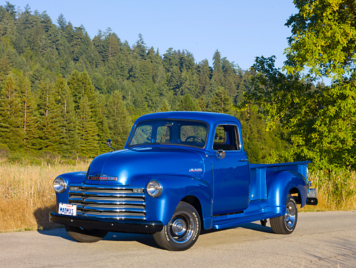 AUT 14 RK1647 01 © Kimball Stock 1948 Chevrolet Thriftmaster Pickup Truck Blue 3/4 Front View On Pavement By Meadow And Trees