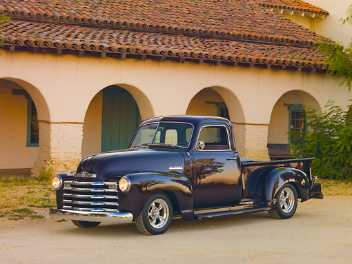 AUT 14 RK1662 01 © Kimball Stock 1948 Chevrolet 1/2 Ton Pickup Truck Black Currant 3/4 Front View On Pavement By Building