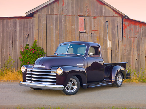 AUT 14 RK1663 01 © Kimball Stock 1948 Chevrolet 1/2 Ton Pickup Truck Black Currant 3/4 Front View On Pavement By Old Wooden Structure