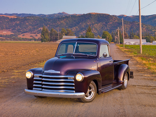 AUT 14 RK1668 01 © Kimball Stock 1948 Chevrolet 1/2 Ton Pickup Truck Black Currant 3/4 Front View On Pavement By Farm