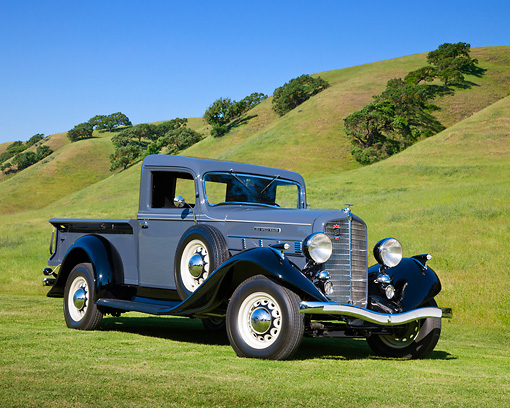 AUT 14 RK1670 01 © Kimball Stock 1935 Reo Speedwagon GAP Pickup Truck Gray And Black 3/4 Front View On Grass By Hills