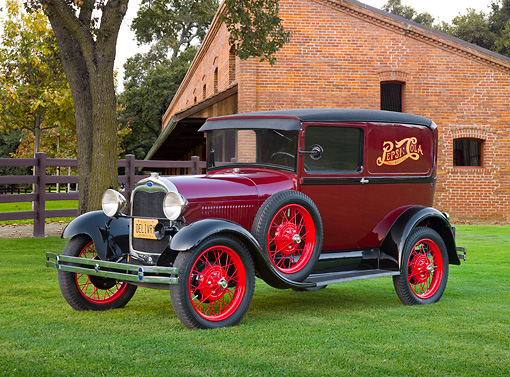 AUT 14 RK1675 01 © Kimball Stock 1929 Ford Model A Delivery Sedan Pepsi Red 3/4 Front View On Grass By Trees And Brick Building