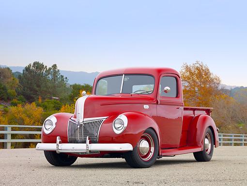 AUT 14 RK1676 01 © Kimball Stock 1941 Ford Pickup Truck Red 3/4 Front View On Pavement By Fence And Autumn Trees
