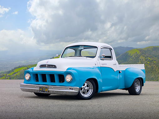 AUT 14 RK1678 01 © Kimball Stock 1957 Studebaker Transtar Pickup Truck Teal And White 3/4 Front View On Pavement By Grassy Hills