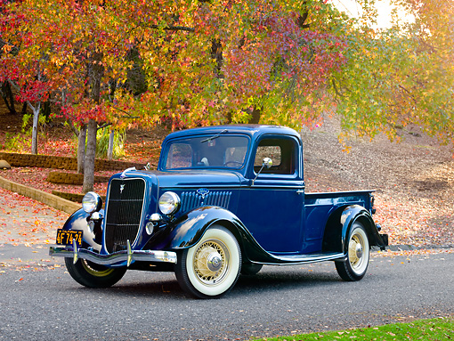 AUT 14 RK1681 01 © Kimball Stock 1935 Ford 1/2 Ton Pickup Truck Blue Over Black 3/4 Front View On Pavement By Autumn Trees