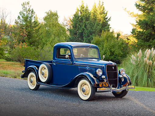 AUT 14 RK1682 01 © Kimball Stock 1935 Ford 1/2 Ton Pickup Truck Blue Over Black 3/4 Front View On Pavement By Trees