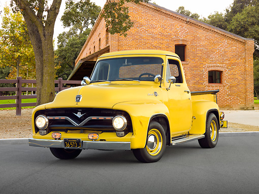 AUT 14 RK1683 01 © Kimball Stock 1955 Ford F-100 Pickup Truck Yellow 3/4 Front View On Pavement By Brick Building