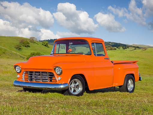 AUT 14 RK1685 01 © Kimball Stock 1956 Chevrolet Pickup Truck Orange 3/4 Front View On Grass