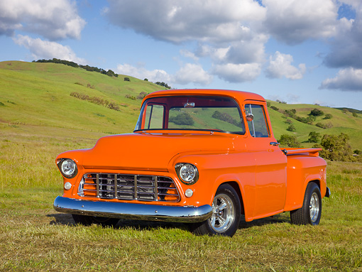 AUT 14 RK1686 01 © Kimball Stock 1956 Chevrolet Pickup Truck Orange 3/4 Front View On Grass