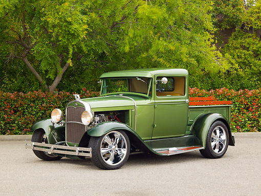 AUT 14 RK1693 01 © Kimball Stock 1930 Ford Model A Green 3/4 Front View On Pavement By Trees