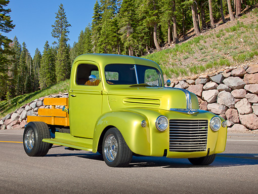 AUT 14 RK1697 01 © Kimball Stock 1947 Ford Pickup Flatbed Lime Gold 3/4 Front View On Pavement By Pine Trees