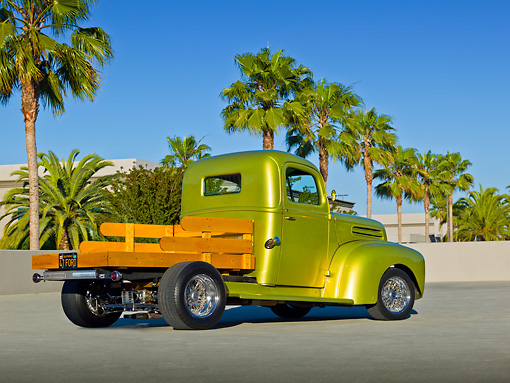 AUT 14 RK1701 01 © Kimball Stock 1947 Ford Pickup Flatbed Lime Gold 3/4 Rear View On Pavement By Palm Trees
