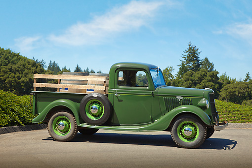 AUT 14 RK1706 01 © Kimball Stock 1935 Ford Pickup Green With Barrels Profile View On Pavement By Trees