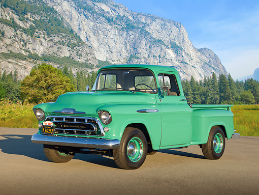 AUT 14 RK1707 01 © Kimball Stock 1957 Chevrolet 3100 Pickup Green 3/4 Front View On Pavement By Mountains