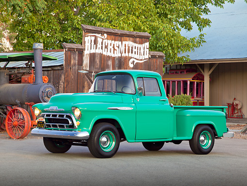 AUT 14 RK1711 01 © Kimball Stock 1957 Chevrolet 3100 Pickup Green 3/4 Front View On Pavement By Old Building