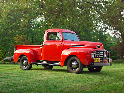 AUT 14 RK1719 01 © Kimball Stock 1948 Ford F-1 Pickup Red 3/4 Front View On Grass By Trees