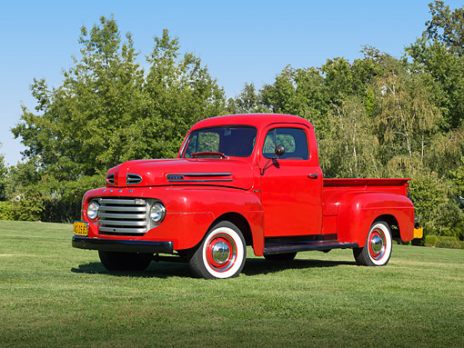 AUT 14 RK1720 01 © Kimball Stock 1949 Ford F-1 Pickup Red 3/4 Front View On Grass By Trees