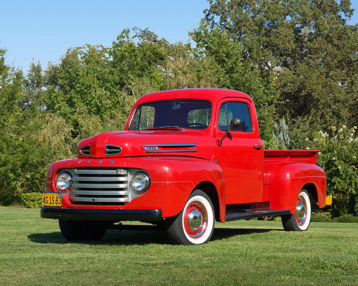 AUT 14 RK1721 01 © Kimball Stock 1949 Ford F-1 Pickup Red 3/4 Front View On Grass By Cornfield