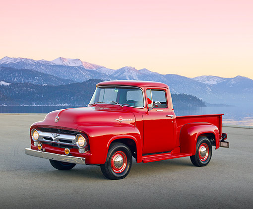 AUT 14 RK1725 01 © Kimball Stock 1956 Ford F-100 Red With Whizzer Motorbike 3/4 Front View On Pavement By Water And Icy Mountains