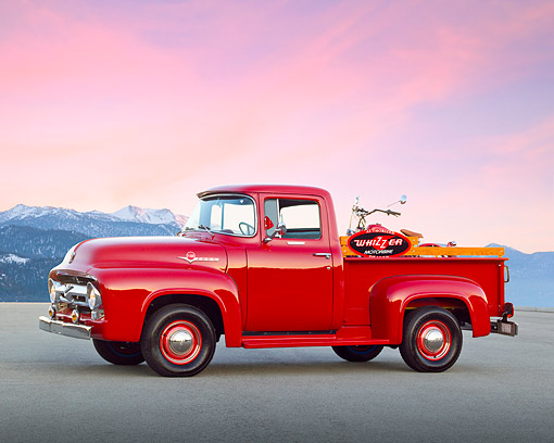 AUT 14 RK1727 01 © Kimball Stock 1956 Ford F-100 Red With Whizzer Motorbike 3/4 Side View On Pavement By Icy Mountains