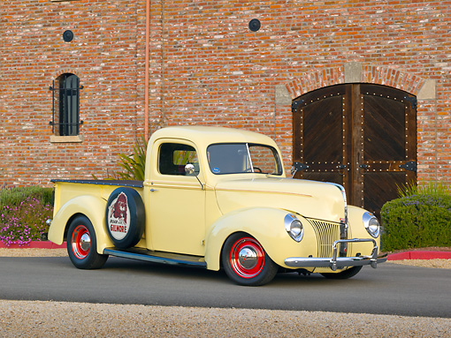 AUT 14 RK1730 01 © Kimball Stock 1941 Ford Pickup Yellow 3/4 Front View On Pavement By Brick Building