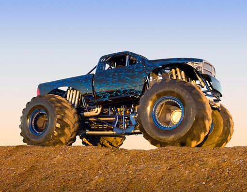 AUT 14 RK1737 01 © Kimball Stock 2011 Dodge Ram Monster Truck Black With Blue Flames 3/4 Side View On Dirt Hill