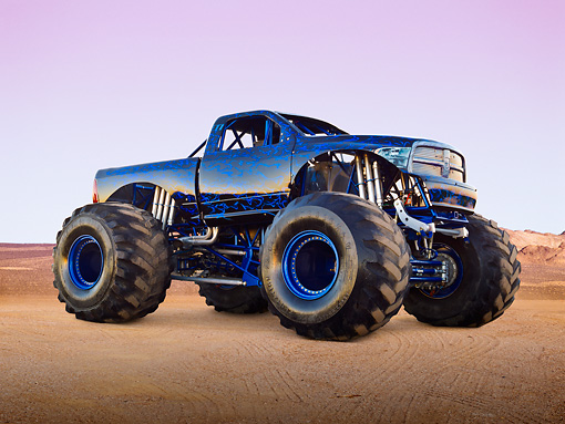 AUT 14 RK1739 01 © Kimball Stock 2011 Dodge Ram Monster Truck Black With Blue Flames 3/4 Front View On Sand