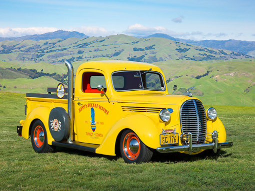 AUT 14 RK1746 01 © Kimball Stock 1938 Ford Pickup Corvette Yellow With Pipes 3/4 Front View On Grass By Hills