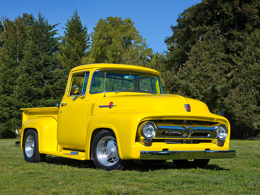 AUT 14 RK1749 01 © Kimball Stock 1956 Ford F-100 Vivid Canary Yellow 3/4 Front View On Grass By Trees