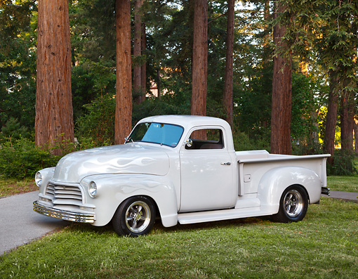 AUT 14 RK1754 01 © Kimball Stock 1951 GMC Pickup Gray With Ghost Flames 3/4 Side View On Grass By Redwoods