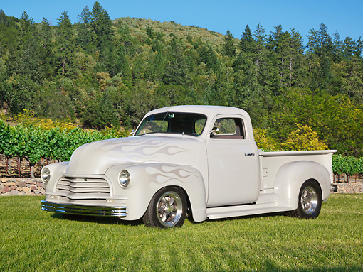 AUT 14 RK1755 01 © Kimball Stock 1951 GMC Pickup Gray With Ghost Flames 3/4 Side View On Grass By Trees