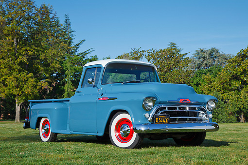 AUT 14 RK1760 01 © Kimball Stock 1957 Chevrolet 3200 Pickup Dove Blue 3/4 Front View On Grass By Trees