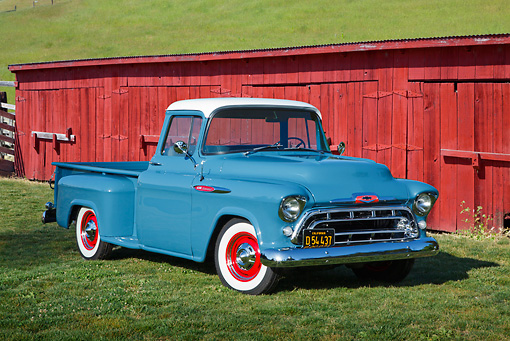 AUT 14 RK1762 01 © Kimball Stock 1957 Chevrolet 3200 Pickup Dove Blue 3/4 Front View On Grass By Red Barn