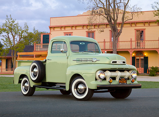 AUT 14 RK1776 01 © Kimball Stock 1952 Ford F-1 Pickup Glen Mist Green 3/4 Front View On Pavement By Building