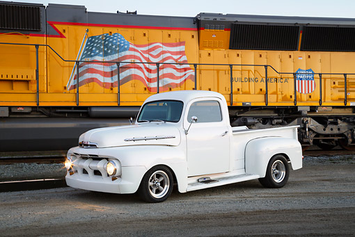 AUT 14 RK1796 01 © Kimball Stock 1951 Ford F-1 White Pearl 3/4 Side View On Pavement By Train