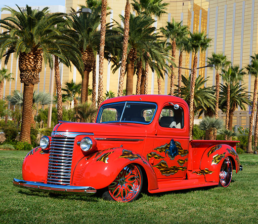 AUT 14 RK1799 01 © Kimball Stock 1940 Chevrolet Pickup Red With Grim Reaper Graphic 3/4 Front View On Grass By Palm Trees