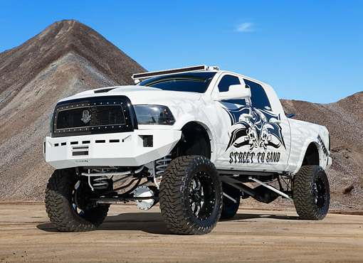 AUT 14 RK1802 01 © Kimball Stock 2012 Dodge Ram Mega Cab White With Graphics 3/4 Front View On Sand By Pile Of Gravel