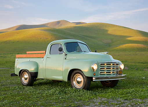 AUT 14 RK1805 01 © Kimball Stock 1949 Studebaker 2R5 Pickup Green 3/4 Front View On Grass By Hills