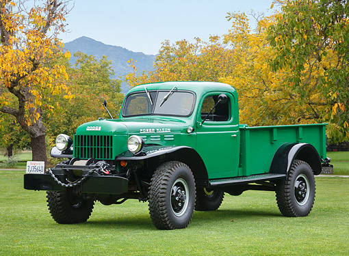 AUT 14 RK1811 01 © Kimball Stock 1949 Dodge Power Wagon Green 3/4 Front View On Grass By Autumn Trees