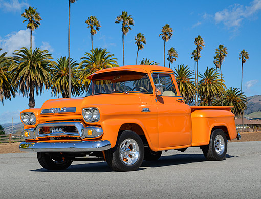 AUT 14 RK1814 01 © Kimball Stock 1959 GMC 100 Pickup Truck Orange 3/4 Front View On Pavement By Palm Trees