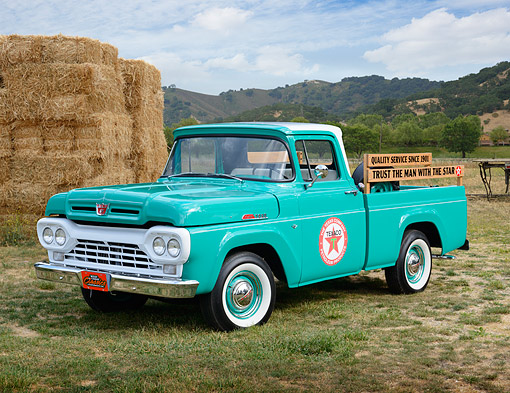 AUT 14 RK1819 01 © Kimball Stock 1960 Ford F-100 Texaco Green 3/4 Front View On Grass By Hay Bales