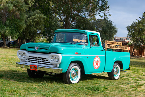 AUT 14 RK1820 01 © Kimball Stock 1960 Ford F-100 Texaco Green 3/4 Front View On Grass By Trees