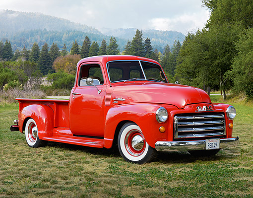 AUT 14 RK1824 01 © Kimball Stock 1949 GMC Long Bed Pickup Budweiser Red 3/4 Front View On Grass In Foggy Mountains