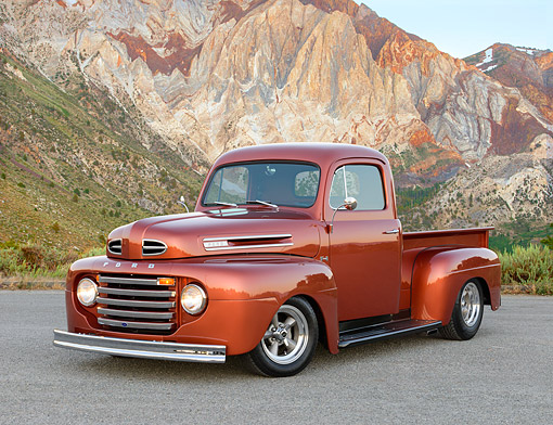 AUT 14 RK1828 01 © Kimball Stock 1948 Ford F-1 Pickup Copper 3/4 Front View On Gravel By Mountains