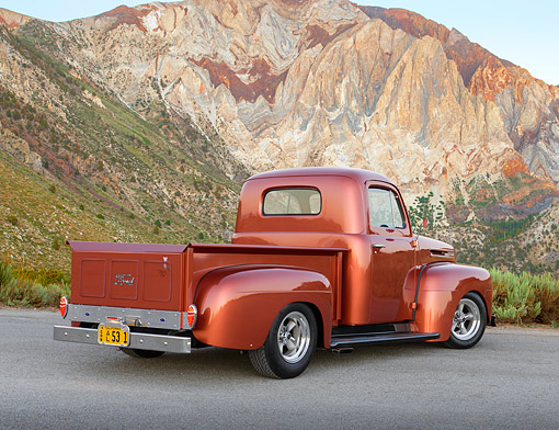 AUT 14 RK1829 01 © Kimball Stock 1948 Ford F-1 Pickup Copper 3/4 Rear View On Gravel By Mountains