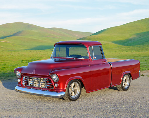AUT 14 RK1830 01 © Kimball Stock 1955 Chevrolet Cameo Pickup Black Cherry 3/4 Front View On Gravel By Grassy Hills